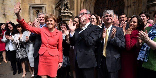 Scotland's First Minister and leader of the Scottish National Party (SNP), Nicola Sturgeon (L), poses...