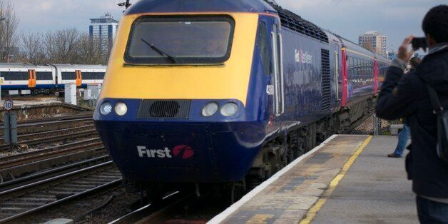 43180 leads 43003 through Clapham Junction working the 1V40 1107 London Waterloo to Penzance. First Great...