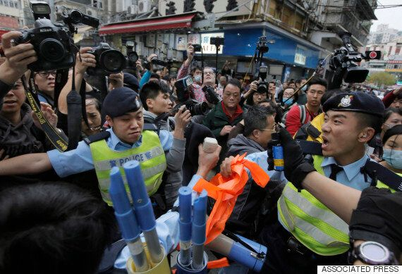 Hong Kong Protestor Convicted Of Assaulting Police Officer With Her
