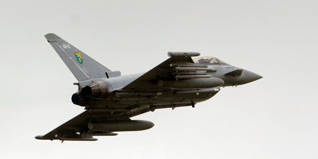 A British Royal Air Force (RAF) Typhoon jet fighter departs Gioia del Colle air base, Italy, Tuesday,...