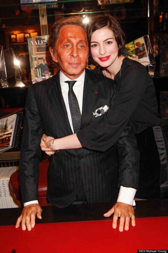 Valentino's Tan Disaster: Fashion Designer Overdoes It Before Posing With Anne Hathaway