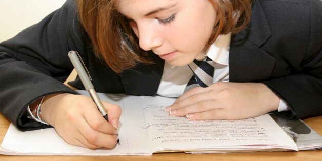 Education, School, Girl in uniform writing in exercise