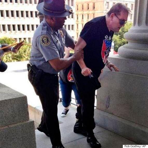 KKK Rally Image Of Black Officer Helping Heat Stricken White Supremacist Goes
