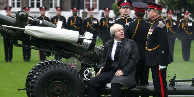 The Mayor of London Boris Johnson joins members of the Armed Forces and volunteers to fire a salute from...