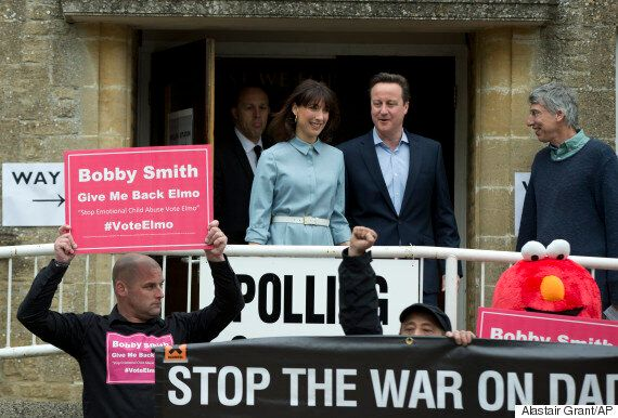 David Cameron Photobombed By Elmo At Polling Station on General Election Day
