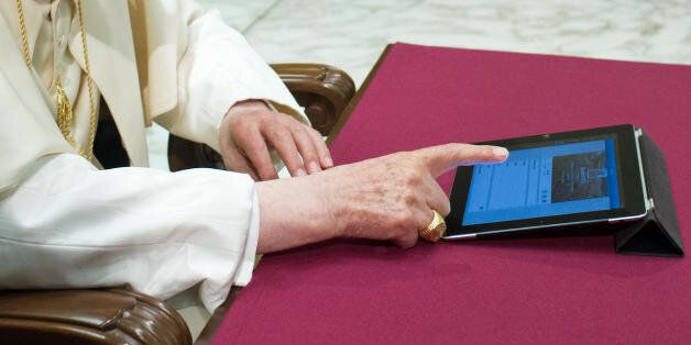 In this photo provided by the Vatican newspaper L'Osservatore Romano, Pope Benedict XVI pushes a button...