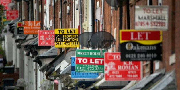 BIRMINGHAM, UNITED KINGDOM - OCTOBER 14: An array of To Let and For Sale signs protrude from houses in...