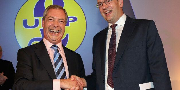 DONCASTER, ENGLAND - SEPTEMBER 27: Conservative MP Mark Reckless (R) is welcomed to UKIP by party leader...