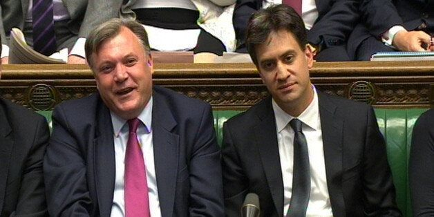 Shadow chancellor Ed Balls and Labour party leader Ed Miliband during Prime Minister's Questions in the...