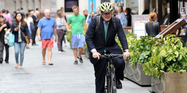 LONDON, ENGLAND - JULY 08: Boris Johnson rides his bicycle outside Global House on July 8, 2015 in London,...