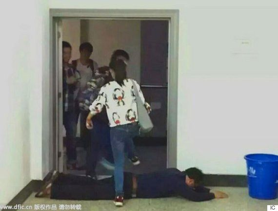 Chinese Professors Makes Students Walk Over Him To Encourage Them To 'Throw Eggs At