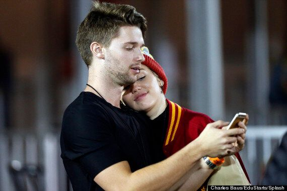 Miley Cyrus Snapped Kissing Rumoured New Boyfriend Patrick Schwarzenegger At Football Game