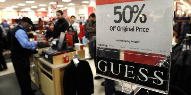 A sign touts discounted merchandise in the Macy's store in downtown Seattle