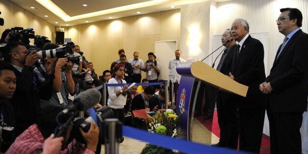 Malaysia's Prime Minister Najib Razak (2nd-R) delivers a statement on the missing Malaysia Airlines flight...