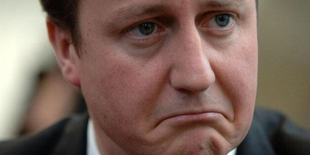 Leader of the Conservative party David Cameron listens to constituents of Reading East talking about...