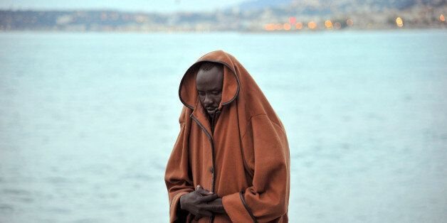 A migrant stands by the sea in Ventimiglia, at the Italian-French border, Tuesday, June 16, 2015. Police...