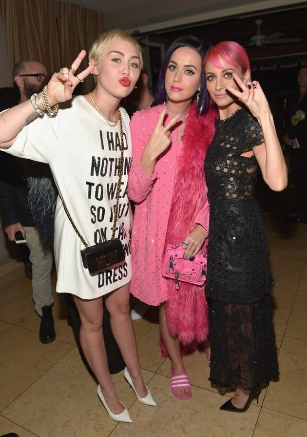 WEST HOLLYWOOD, CA - JANUARY 22: (L-R) Recording artists Miley Cyrus, Katy Perry and designer Nicole...