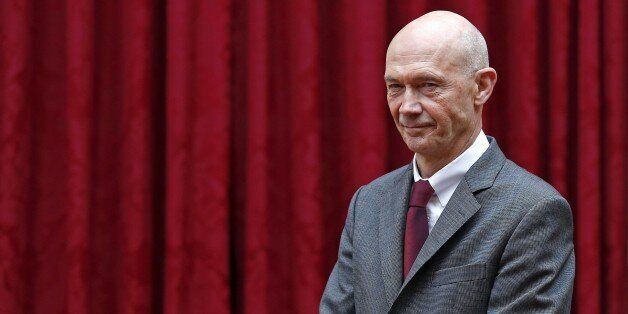 World Trade Organization (WTO) Director-General Pascal Lamy poses before being awarded with the 'Commandeur...