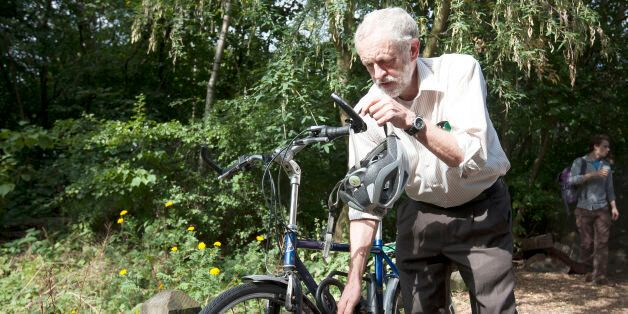Labour leadership contender Jeremy Corbyn arrives by bicycle to launch his new policies on the environment...
