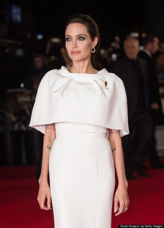 Angelina Jolie Wows In White At 'Unbroken' London Premiere