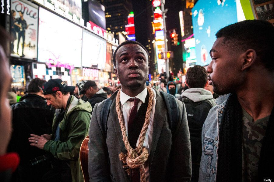 Ferguson Protestors Flood New York's Times Square As Grand Jury Clears Darren