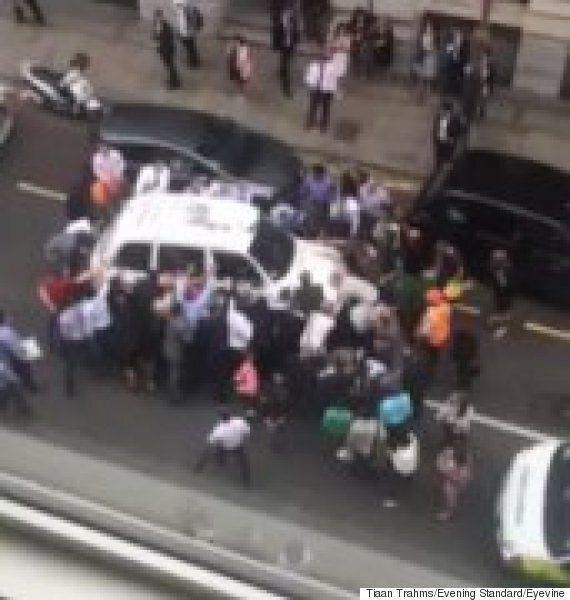 Londoners Rally To Lift Black Cab Off Injured