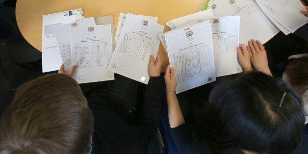 Pupils from Craigmount High School in Edinburgh open their Scottish Higher exam