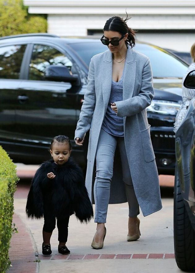 NO JUST JARED USAGE Kim Kardashian and her baby North, dressed in a black fur cape, arriving at a friend's...