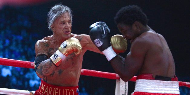 US actor Mickey Rourke, left, punches his opponent Elliot Seymour of the United States, during their...