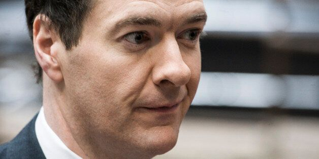 British Chancellor of the Exchequer George Osborne at the start of a European finance ministers meeting...
