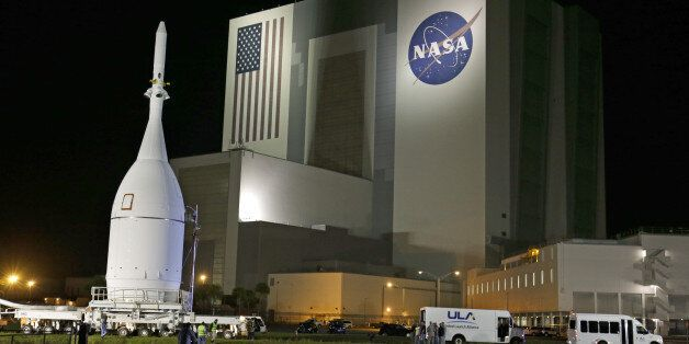 The Orion Spacecraft moves by the Vehicle Assembly Building on its approximately 22 mile journey from...