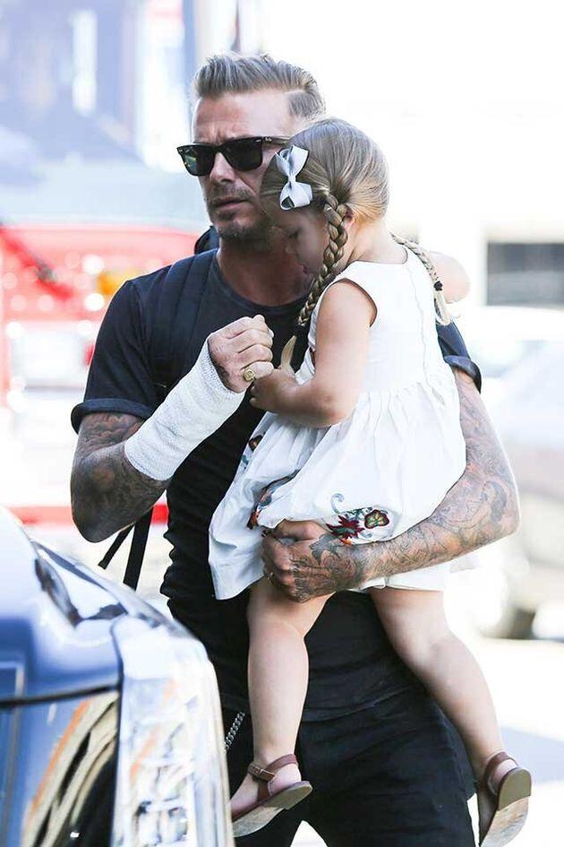 David Beckham Holds His Daughter Harper After Motorbike
