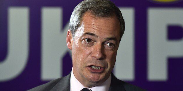 UK Independence Party (UKIP) party leader Nigel Farage speaks to a journalist in Rochester, Kent on November...