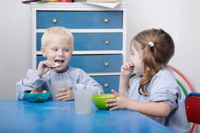 Children eating snacks in classroom