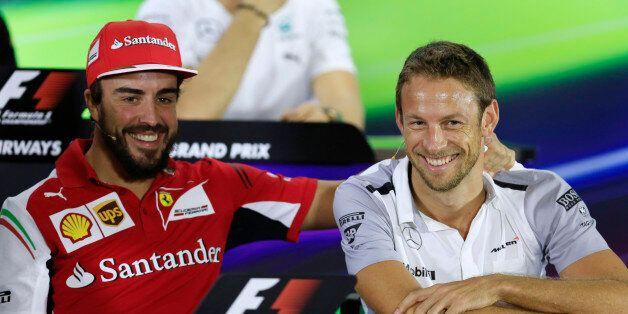 Ferrari driver Fernando Alonso of Spain, left, and McLaren Mercedes driver Jenson Button of Britain share...