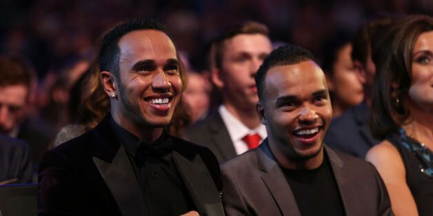 Lewis Hamilton with brother Nic during the 2014 Sports Personality of the Year Awards at the SSE Hydro,