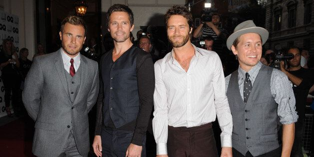 Gary Barlow, Jason Orange, Howard Donald and Mark Owen of Take That arrive at the 2009 GQ Men of the...