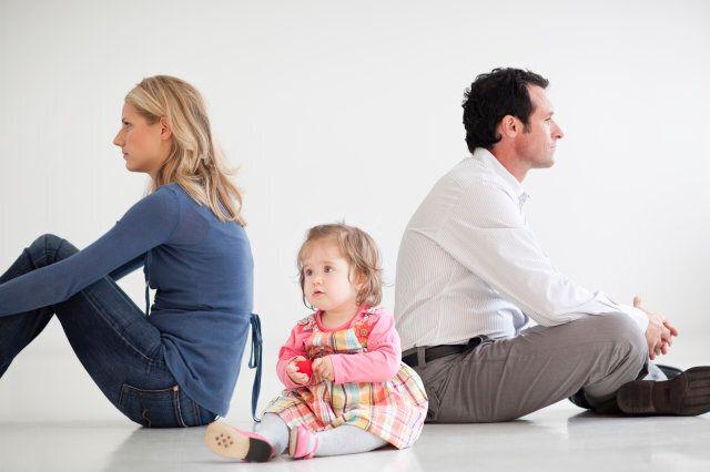 Upset couple sitting with baby girl