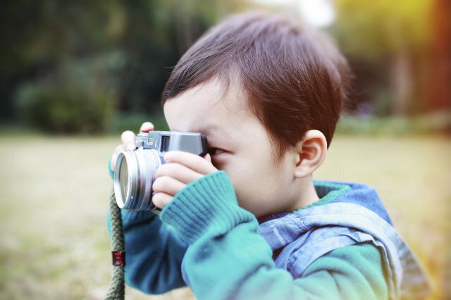 cute child plays the photographer
