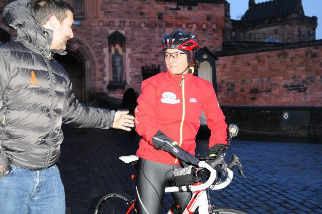 EDINBURGH, UNITED KINGDOM - FEBRUARY 08: Davina McCall says goodbye to her husband Matthew as she sets off on her BT Sport Relief Challenge in which she will attempt to cycle, swim and run 500 miles from Edinburgh to London in 7 days at Edinburgh Castle on February 8, 2014 in Edinburgh, Scotland. (Photo by Martin Fraser/Getty Images)
