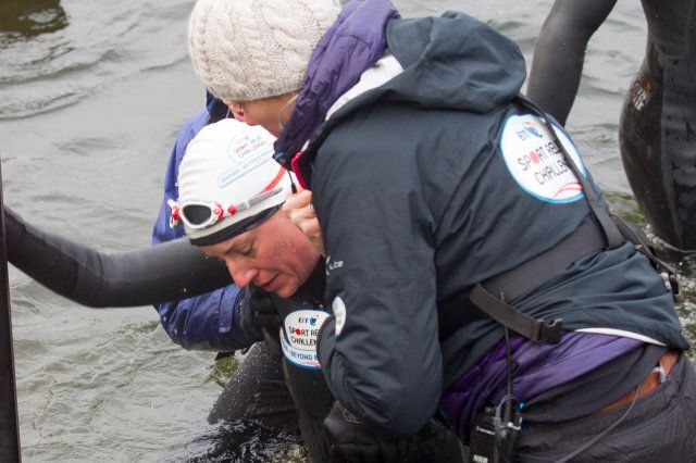 Windermere, Cumbria, UK. 10th February 2013. Windermere, Cumbria, UK. 10th February, 2014. Davina McCall Sport Relief challenge DAY 3 Davina McCall -Having collapsed after swimming across Lake Windermere being helped of the lake Davina - Beyond Breaking Point Starts the day swimming across Lake Windermere Landing at the Low Wood Bay Marina, on Lake Windermere, Lake District National park Davina McCall is running, swimming and cycle over 500 miles, from Edinburgh to London, in just seven days for Sport Relief© Shoosmith Collection/Alamy Live News