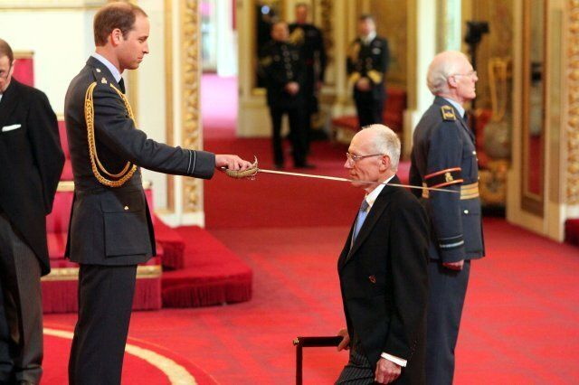 Sir Marcus Setchell from London is made a Knight Commander of the Royal Victorian Order by the Duke of Cambridge during an Investiture ceremony at Buckingham Palace in central London.