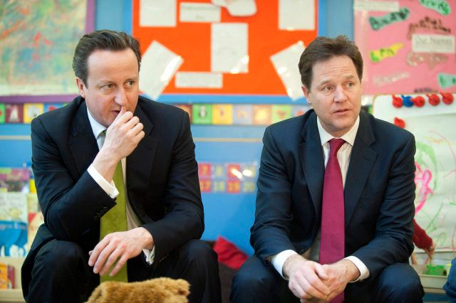 Britain's Prime Minister David Cameron, left, and Deputy Prime Minister Nick Clegg visit the Wandsworth Day Nursery in London, Tuesday March 19, 2013. Britain's government is expected to create a better childcare system for parents. (AP Photo/Jeremy Selwyn, Pool)