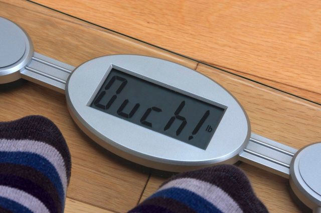 Digital bathroom scales with reading altered to make the word 'ouch!'.