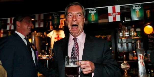 Nigel Farage, leader of Britain's United Kingdom Independence Party (UKIP) enjoys a pint of beer at a...