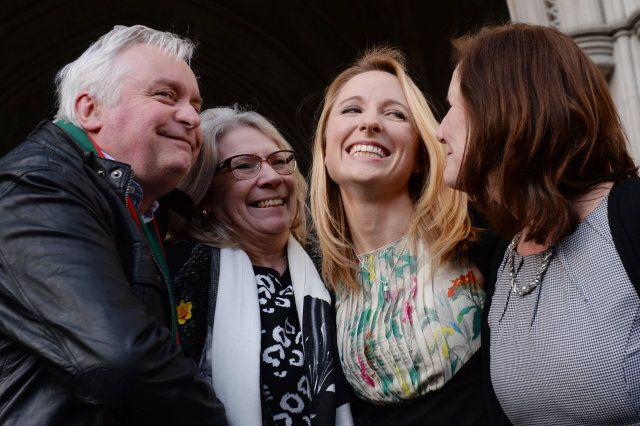 Beth Warren leaves the Law Courts in London with her mother Georgina Hyde (far right), and her in-laws, Kevin and Helen Brewer, after she won her High Court fight to preserve her late husband's sperm.