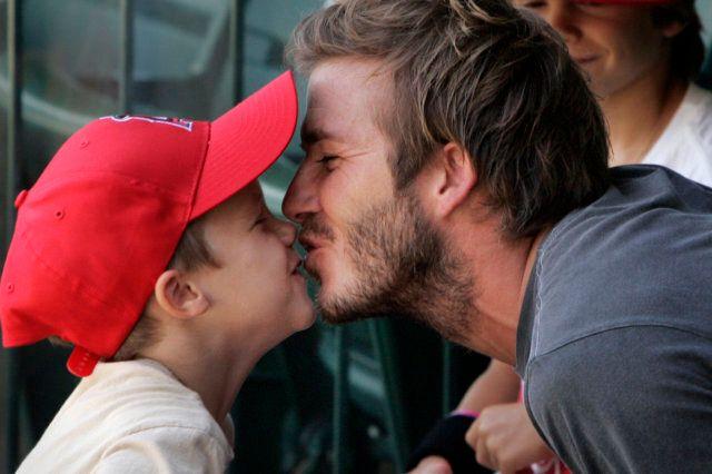 Soccer star David Beckham gets a kiss from son Cruz