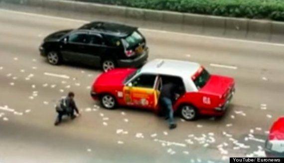 Hong Kong Money Grab As Van Spills £2.8m In Busy Street On Christmas