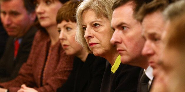 Home Secretary Theresa May and Chancellor George Osborne (centre right) at the first Cabinet meeting...