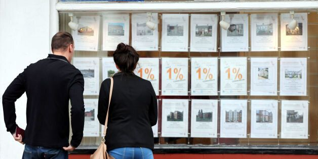 Embargoed to 0001 Tuesday January 6 File photo dated 08/10/13 of a couple looking at houses for sale...